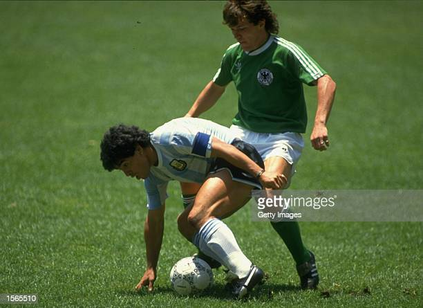 Maradona of Argentina shields the ball from Lothar Matthaus of West Germany during the World Cup Final at the Estadio Azteca in Mexico City Argentina...