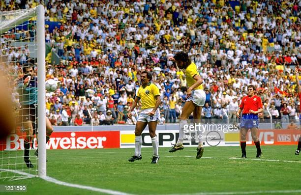 Socrates of Brazil scores during the World Cup match against Spain at the Jalisco Stadium in Guadalajara Mexico Brazil won the match 10 Mandatory...