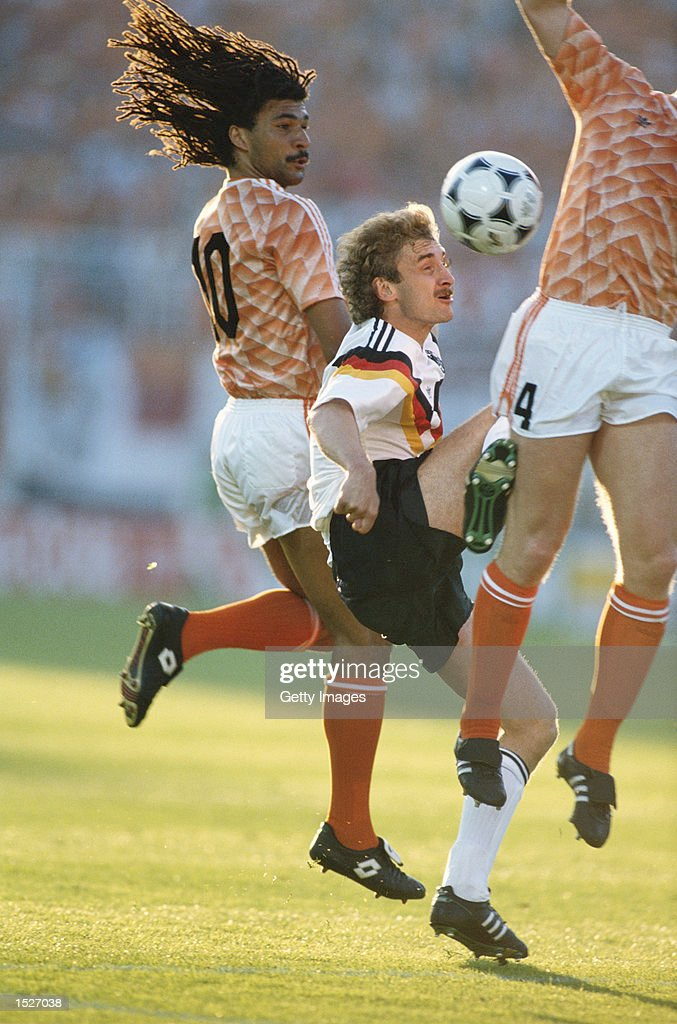 Ruud Gullit of Holland (left) challenges Rudi Voller of Germany (centre) in the semi-final of the European nations championships in Munich, Germany. Mandatory Credit: Allsport UK