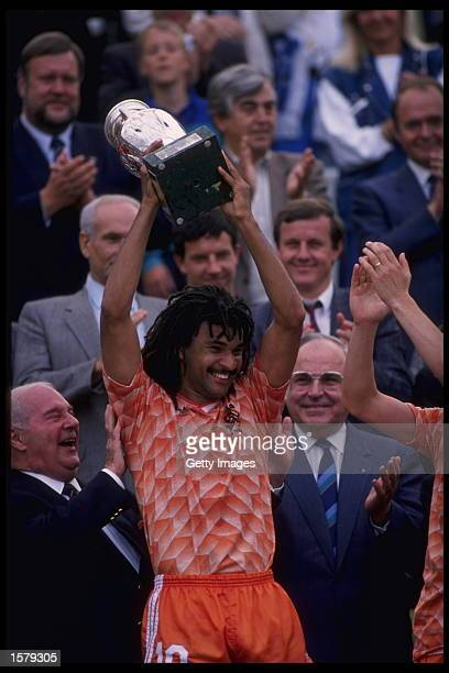Ruud Gullit of Holland hold aloft the European nations trophy after Holland defeats Russia 20 in the Final of the European nations cup in Munich...