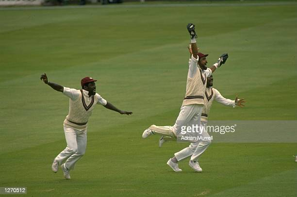 West Indies players celebrate after winning the Second Test match against England at Lord's in London The West Indies won the match by 134 runs...