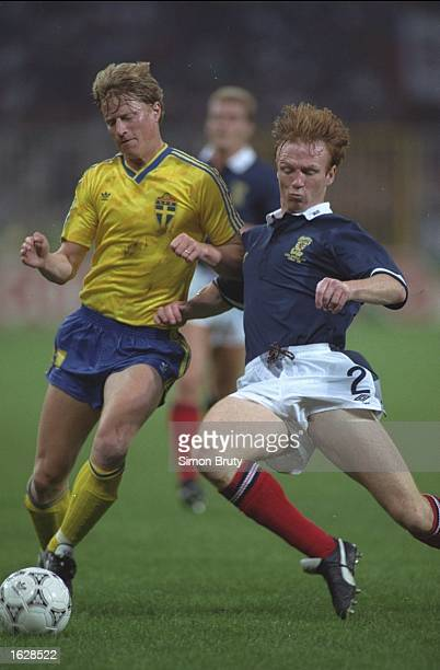 Alex McLeish of Scotland challenges Stefan Pettersson of Sweden during the World Cup match in Genoa Italy Scotland won the match 21 Mandatory Credit...