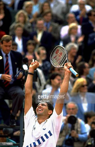 Andres Gomez of Ecuador punches the air in celebration after his victory in the Mens Singles final during the French Open at Roland Garros in Paris...
