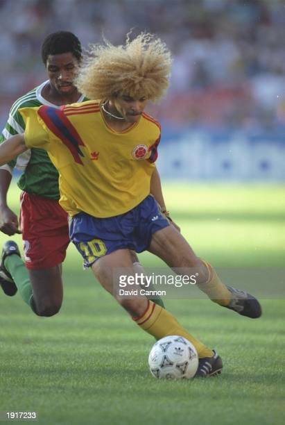 Carlos Valderama of Colombia shields the ball during the World Cup Second Round match against Cameroon at the San Paolo Stadium in Naples, Italy....