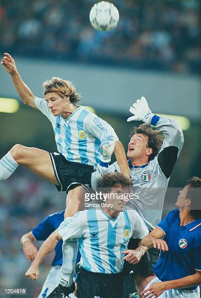 Claudio Caniggia of Argentina in action against Walter Zenga of Italy during the World Cup match between Argentina and Italy in Italy The match...