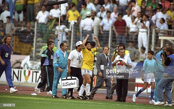 Diego Maradona of Argentina celebrates after the World Cup match against Brazil at the Delle Alpi Stadium in Turin Italy Argentina won the match 10...