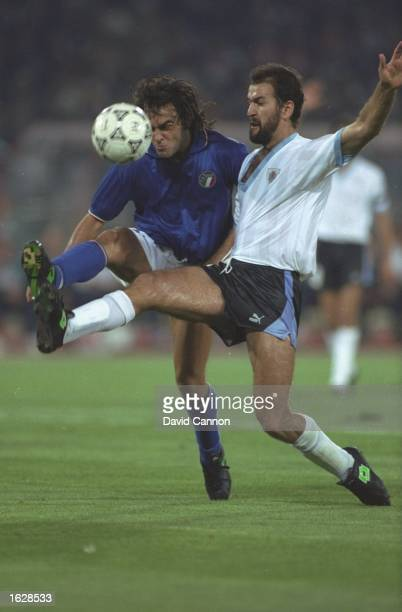 Giuseppe Giannini of Italy challenges Hugo de Leon of Uraguay during the World Cup second round match at the Olympic Stadium in Rome Italy won the...