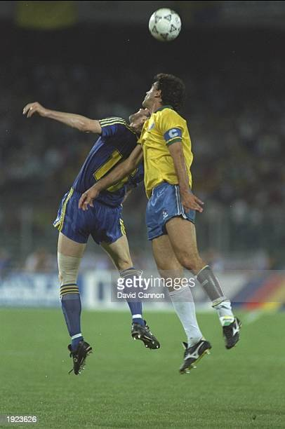 Glen Stranberg of Sweden and Careca of Brazil jump for the ball during the World Cup First Round match at the Delle Alpi Stadium in Turin Italy...