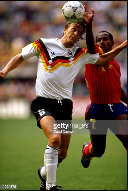 Guido Buchwald of West Germany in action against Carlos Enrique Estrada of Columbia during the World Cup match between West Germany and Columbia...