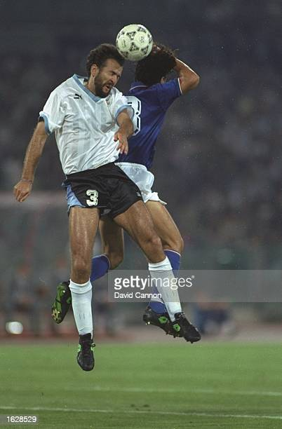 Hugo de Leon of Uraguay and Giuseppe Giannini of Italy both go to head the ball during the World Cup match in Rome Italy won the match 20 Mandatory...