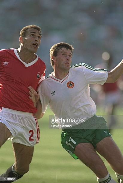 Ibrahim Hassan of Egypt tackles Kevin Sheedy of the Republic of Ireland during the World Cup match in Palermo Italy Mandatory Credit Davis...