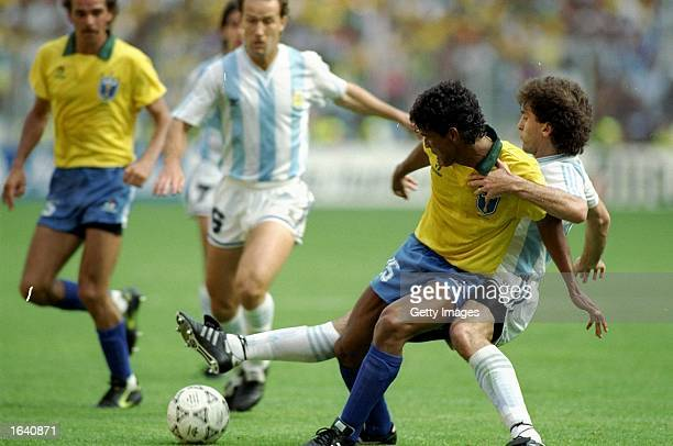Muller of Brazil shields the ball from Ruggeri of Argentina during the World Cup match at the Delle Alpi Stadium in Turin Italy Argentina won the...