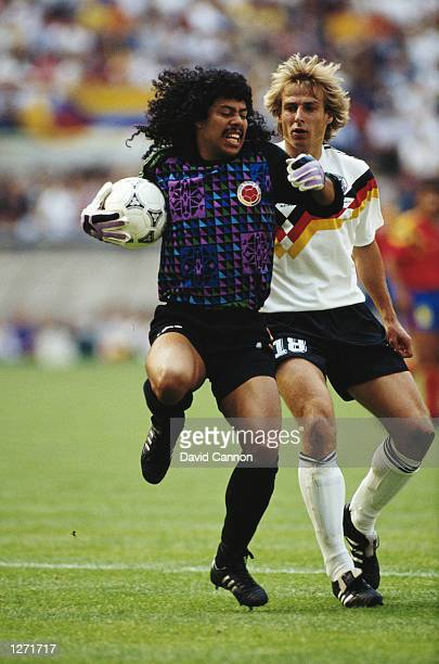 Rene Higuita of Columbia shields the ball from Jurgen Klinsman of West Germany during the World Cup match in Bologna Italy The match ended in a 11...