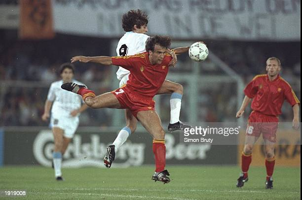 Stephane Demol of Belgium and Enzo Francescoli of Uruguay both go for the ball during the World Cup match in Verona Italy Belgium won the match 31...