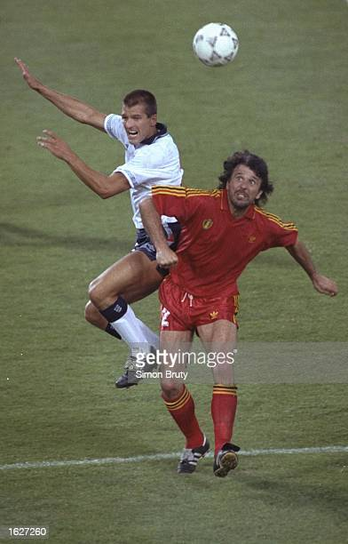 Steve Bull of England and Eric Gerets of Belgium both jump for the ball during the World Cup match in Bologna Italy England won the match 10...