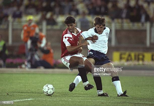 Tarik Soliman of Egypt battles with Peter Beardsley of England during the World Cup match in Cagliari Italy England won the match 10 Mandatory Credit...