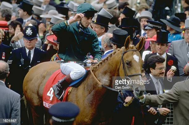 Generous is led into the winners enclosure after winning the Derby at Epsom racecourse in Epsom England Mandatory Credit Dan Smith/Allsport