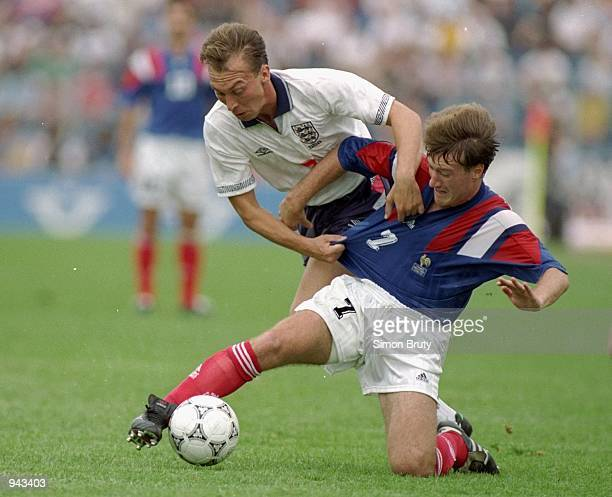 David Platt of England is tackled by Didier Deschamps of France during the European Championship Group 1 match at the Malmo Stadium in Malmo Sweden...