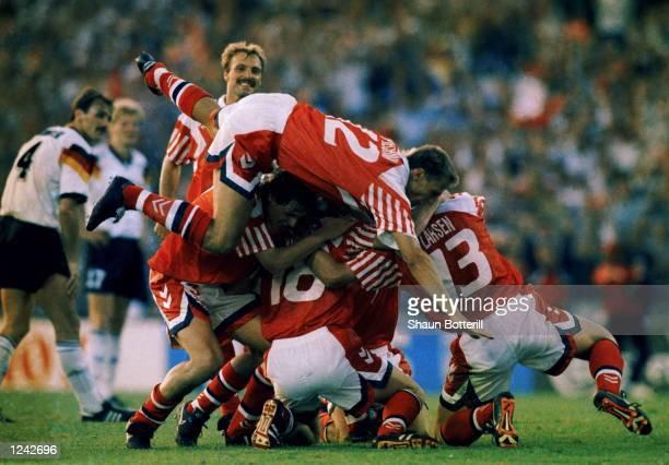 Denmark celebrate Kim Vilfort's winner to make the score 20 in the European soccer championships final against Germany which was played in Gothenburg...