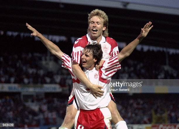 Flemming Avlsen and Henrik Andersen of Denmark celebrate during the European Championship Group 1 match against France at the Malmo Stadium in Malmo...