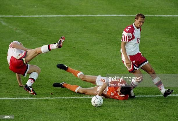 Henrik Larsen of Denmark clashes with Marco Van Basten of Holland during the European Championship SemiFinal at the Ullevi Stadium in Gothenburg...