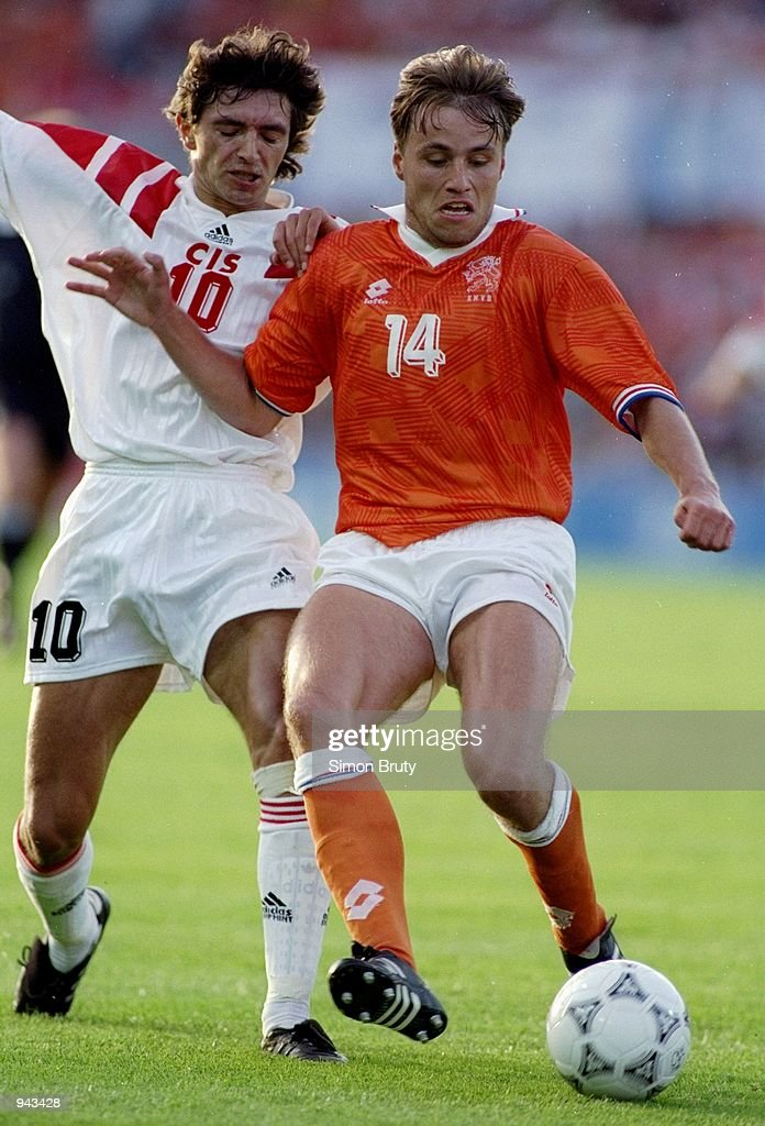Rob Witschge of Holland is challenged by Igor Dobrovoski of the CIS during the European Championship Group 2 match at the Ullevi Stadium in Gothenburg, Sweden. The match ended in a 0-0 draw. \ Mandatory Credit: Simon Bruty /Allsport