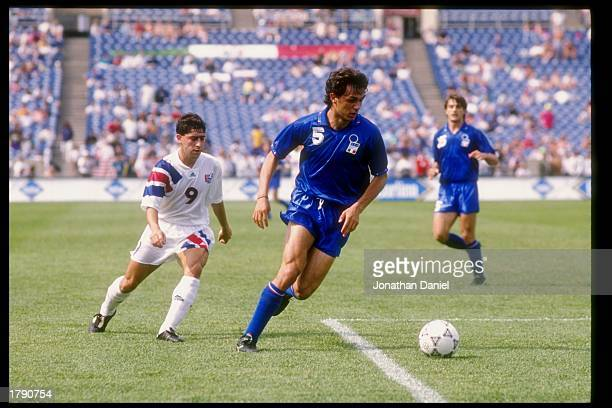 Tab Ramos of the USA and P Maldini of Italy run down the field during a game at Soldier Field in Chicago Illinois Mandatory Credit Jonathan Daniel...