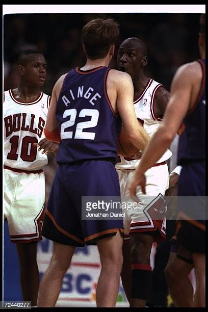 Guard Danny Ainge of the Phoenix Suns and guard Michael Jordan of the Chicago Bulls argue during a NBA finals game at the America West Arena in...