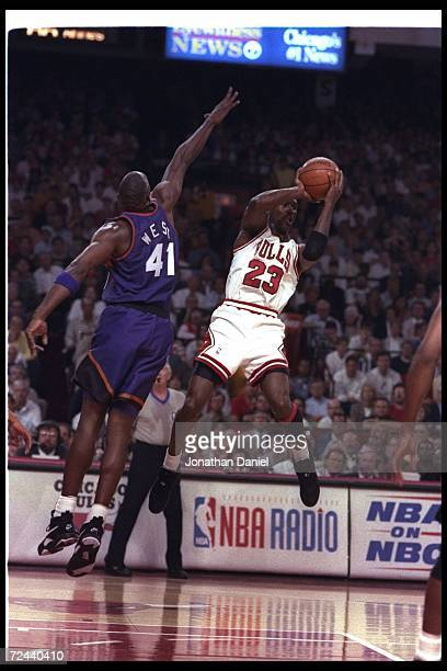 Guard Michael Jordan of the Chicago Bulls goes up for two during Game Five of the NBA finals against the Phoenix Suns at the United Center in Chicago...