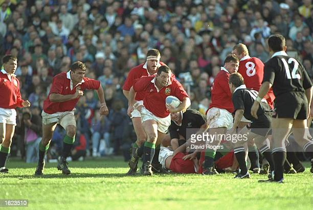 Nick Popplewell of the British Lions emerges with the ball with team mates Rory Underwood Ben Clarke and Martin Bayfield in support during the second...