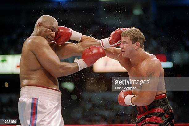Tommy Morrison right and George Foreman in action during a bout in Las Vegas Nevada Mandatory Credit Mark Morrison /Allsport