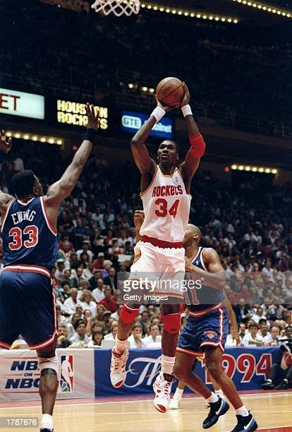 Hakeem Olajuwon of the Houston Rockets goes up for two during the NBA finals game against the New York Knicks Mandatory Credit Allsport /Allsport
