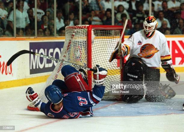 NEW YORK RANGER''S ALEXEI KOVALEV SLIDES PAST CANUCKS GOALTENDER KIRK MCLEAN AFTER SCORING IN THE THIRD PERIOD TO PUT THE RANGERS UP 5-1 DURING GAME...