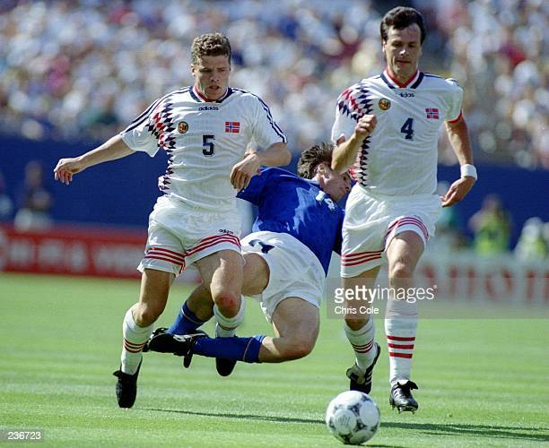 NICOLA BERTI OF ITALY IS SANDWICHED BETWEEN STIG BJORNBYE AND RUNE BRATSETH OF N ORWAY DURING THEIR WORLD CUP GAME AT THE GIANTS STADIUM AT THE...