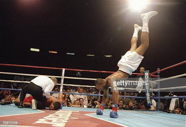Ray Lathon does a headstand as the referee tends to Jesus Castaneda during a bout at the Great Western Forum in Inglewood, California. Lathon won the...