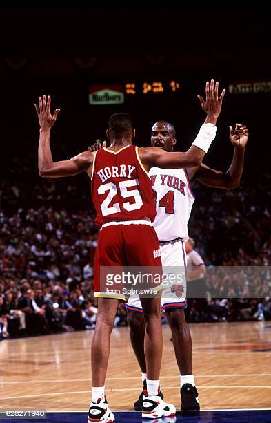 Robert Horry of the Houston Rockets defends Charles Oakley of the New York Kicks during the NBA Finals at Madison Square Garden in Manhattan NY