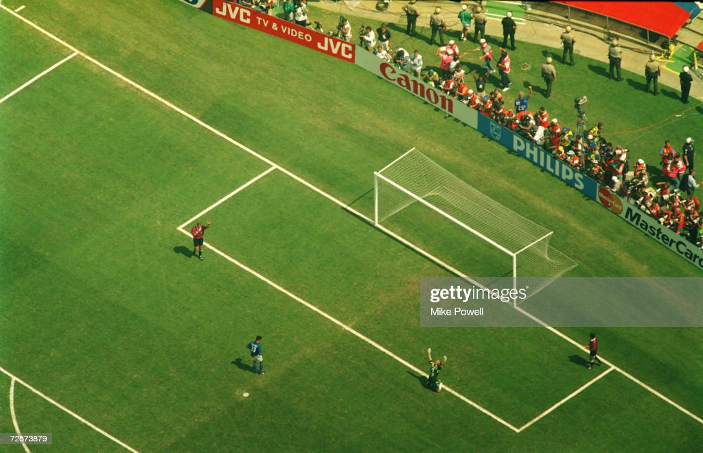 roberto baggio (in blue) misses the decisive penalty as brazilian goalkeeper claudio taffarel falls to his knees and raises his arms in victory as brazil wins the 1994 world cup final. Brazil won during a penaly shoot-out at the Rose Bowl stadium in Pasedena.