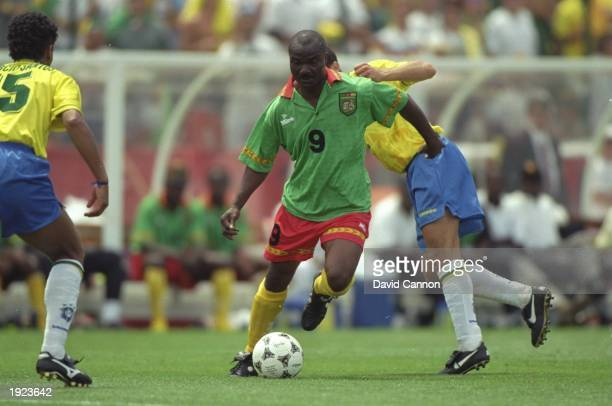 Roger Milla of Cameroon in action during the World Cup match against Brazil at the Stanford Stadium in San Francisco California USA Brazil won the...