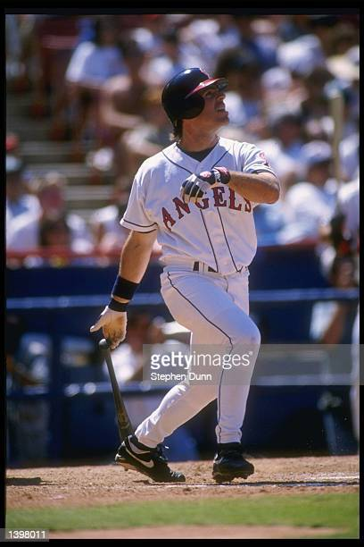 Center fielder Jim Edmonds of the California Angels swings at the ball during a game against the Chicago White Sox at Anaheim Stadium in Anaheim,...