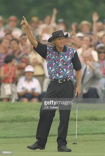 Greg Norman celebrates during the Memorial Tournament at the Muirfield Village golf course in Muirfield Village Ohio