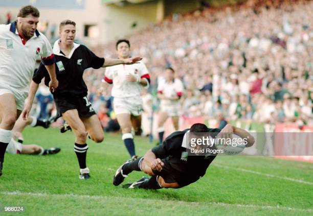 Jonah Lomu of New Zealand dives over for the try during the 1995 Rugby World Cup match between England and New Zealand played in Cape Town, South...