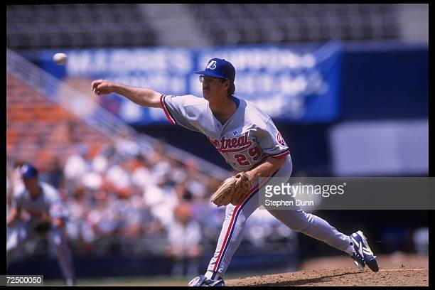 Pitcher Greg Harris of the Montreal Expos slings the ball in the direction of home plate where a San Diego Padre batter awaits its arrival The Padres...