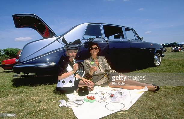 Two race goers have a picnic in the car park on Ladies Day during Royal Ascot week at Ascot racecourse in Ascot England Mandatory Credit Phil...