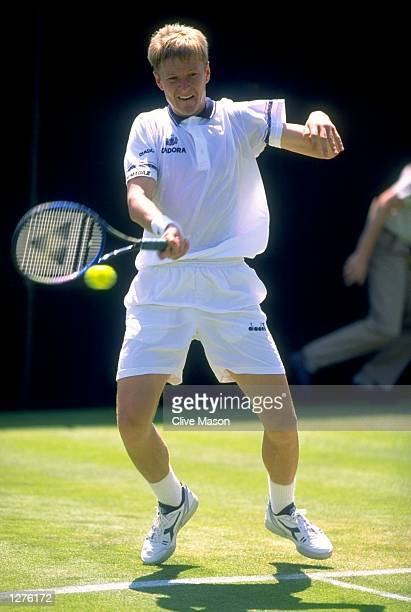 Yevgeny Kafelnikov plays a forehand return during a match at the Lawn Tennis Championships in Wimbledon London Mandatory Credit Clive Mason/Allsport
