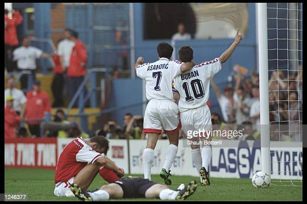 Aljosa Asanovic and Zvonimir Boban of Croatia celebrate victory over Denmark in their Group D match at Hillsbrough during the European Football...