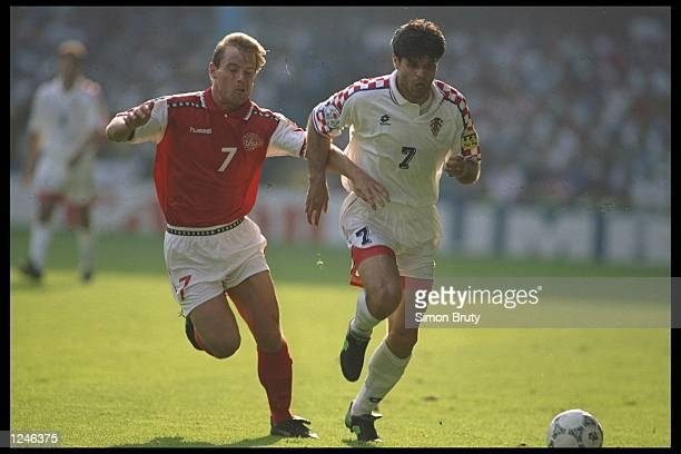 Aljosa Asanovic of Croatia is tackled by Brian Steen Nielsen of Denmark during the Group D match at Hillsbrough during the European Football...