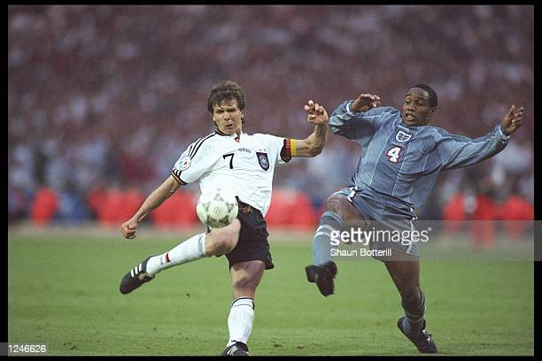 Andreas Moller of Germany left is challenged with Paul Ince of Engalnd during the European championship semi final match between England and Germany...