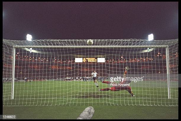 Andreas Moller of Germany scores the winning penalty during the European championship semi final match between England and Germany at Wembley Stadium...