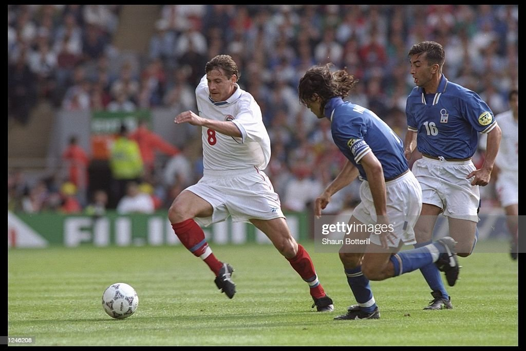 Andrei Kanchelskis of Russia (number 8) is chased by Paolo Maldini of Italy (number 3) : News Photo