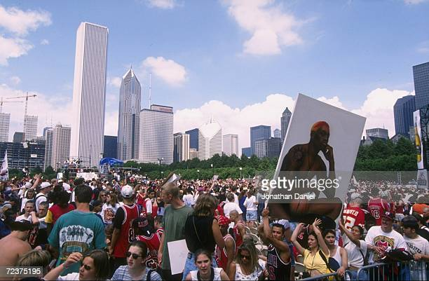 Chicago Bulls fans celebrate during the Bulls victory parade celebrating their 1996 NBA Championship in Chicago Illinois Mandatory Credit Jonathan...